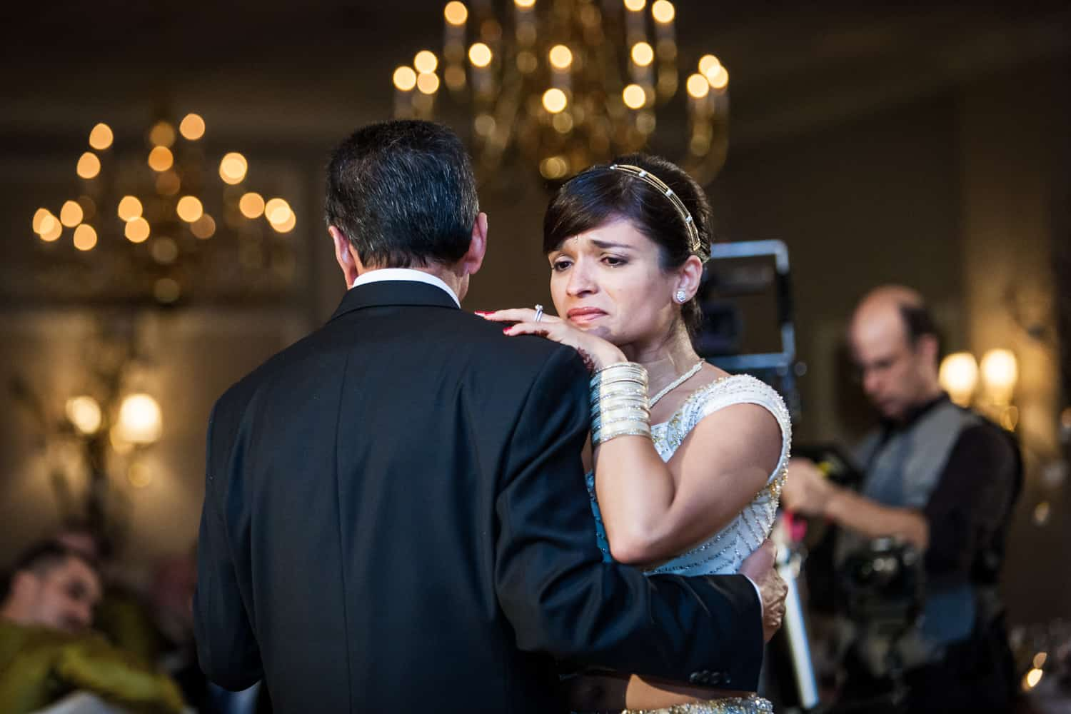 Bride crying while dancing with father at an East Wind Inn wedding reception