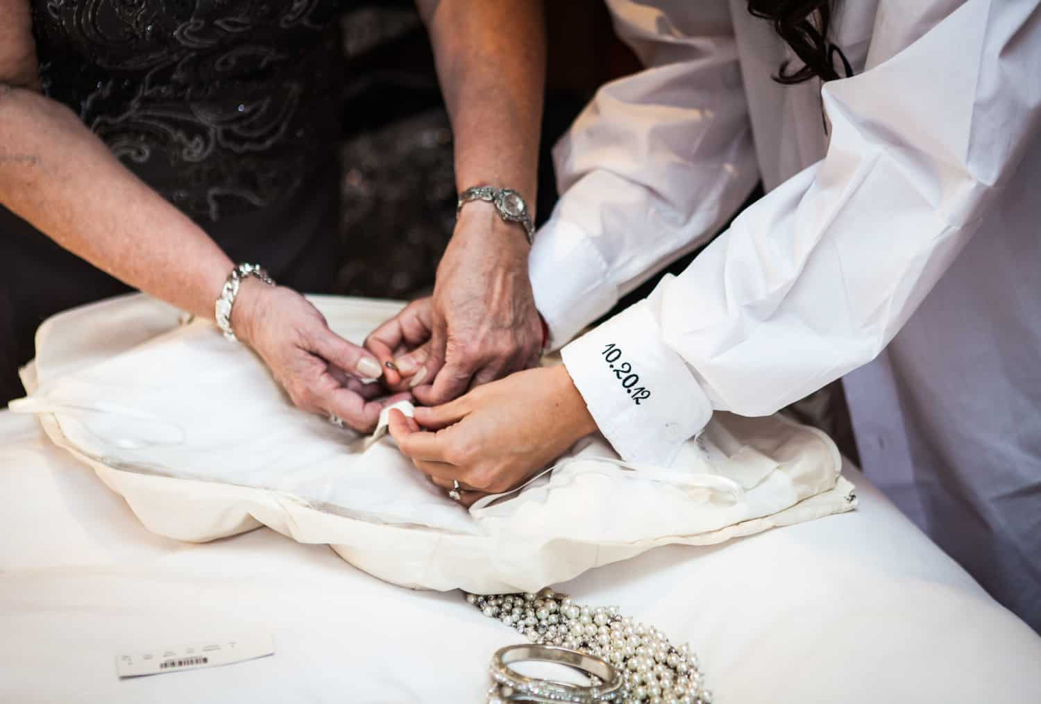 Hands fixing wedding dress