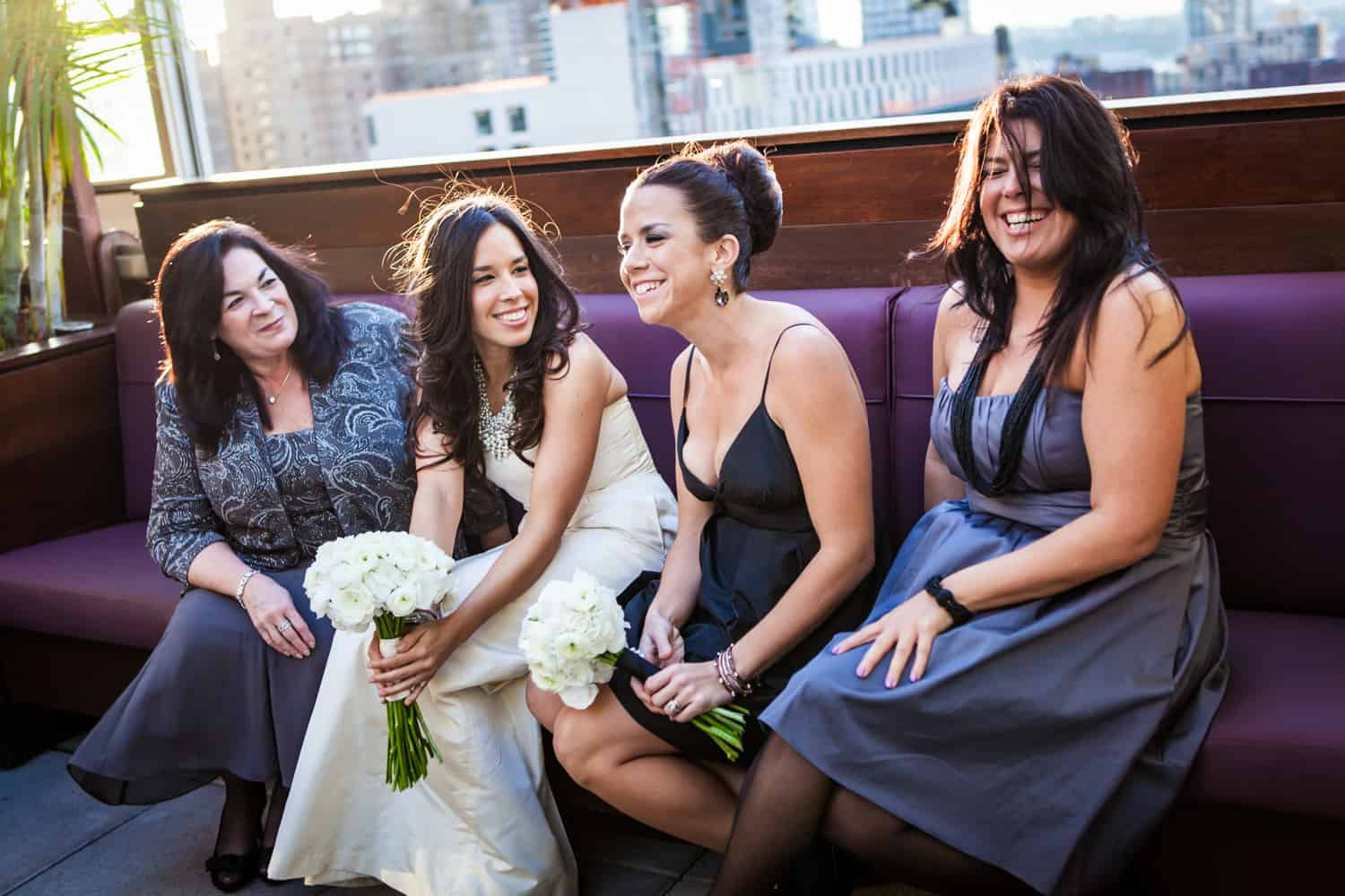 Bride and bridesmaids before Empire Hotel rooftop wedding