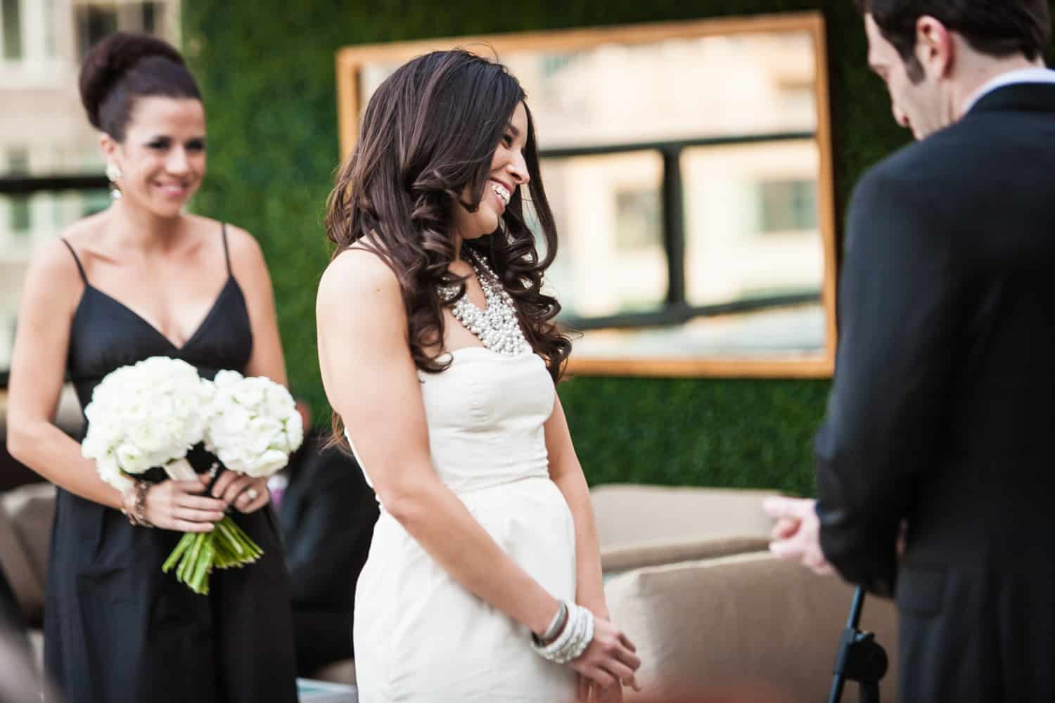 Bride smiling during ceremony at an Empire Hotel rooftop wedding