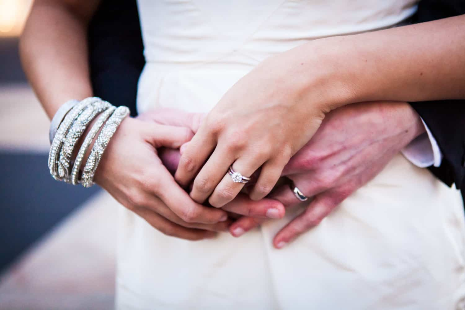 Close up on couple's hands wearing wedding rings