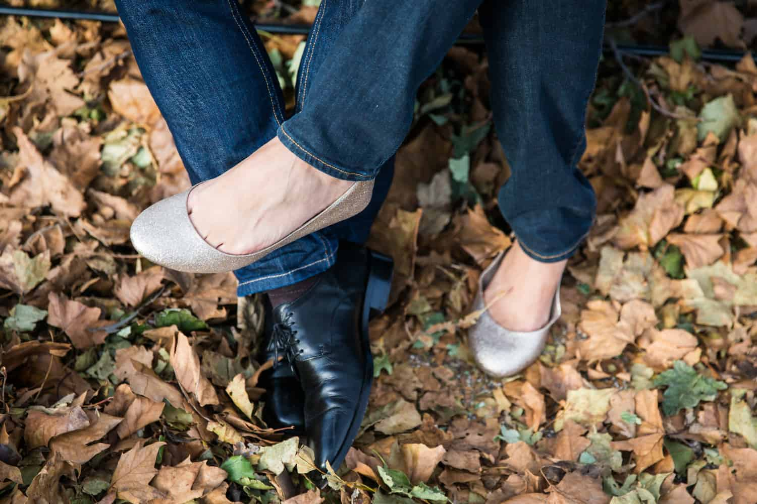Close up of couple's entwined feet wearing shoes
