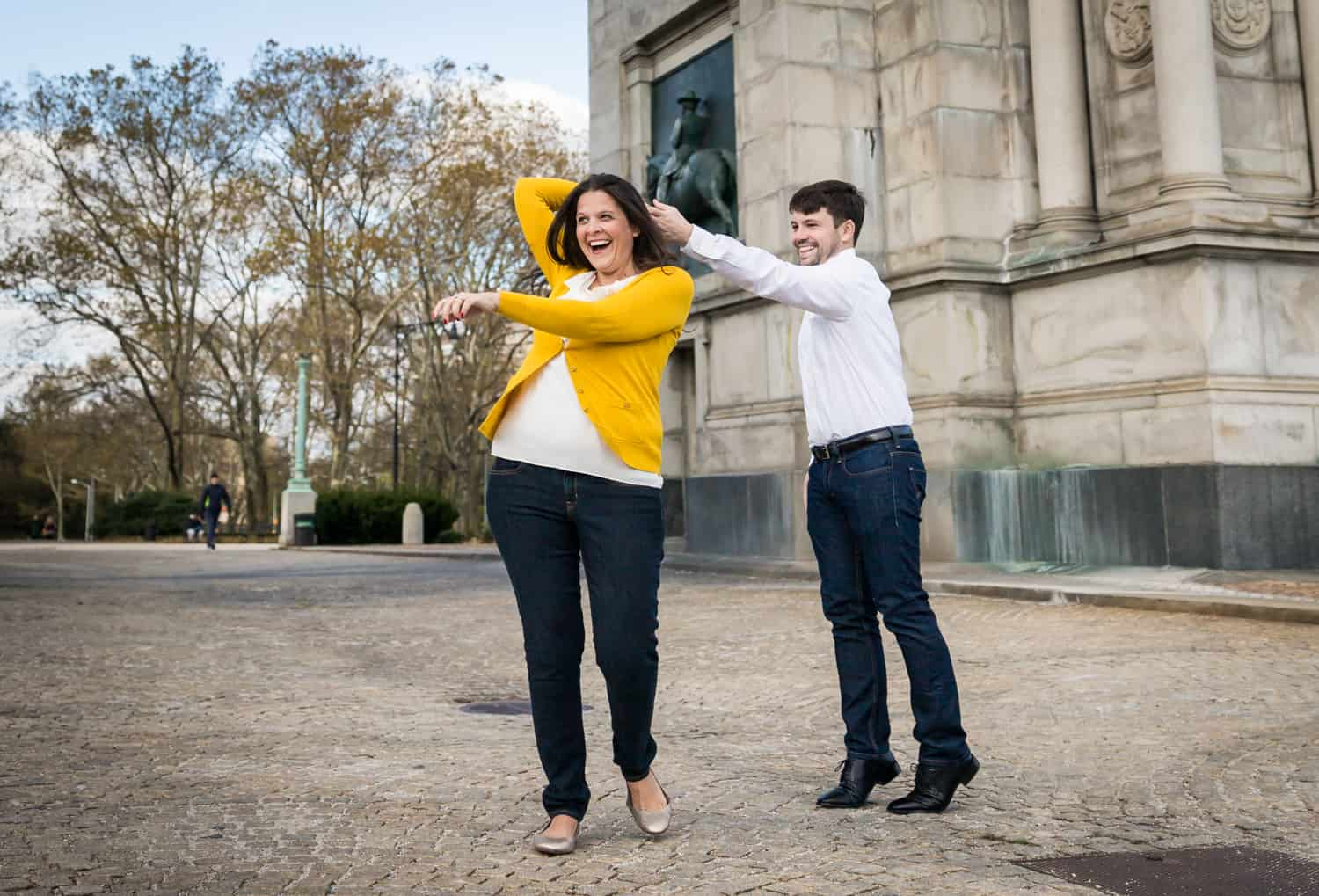 Grand Army Plaza engagement photos of couple dancing