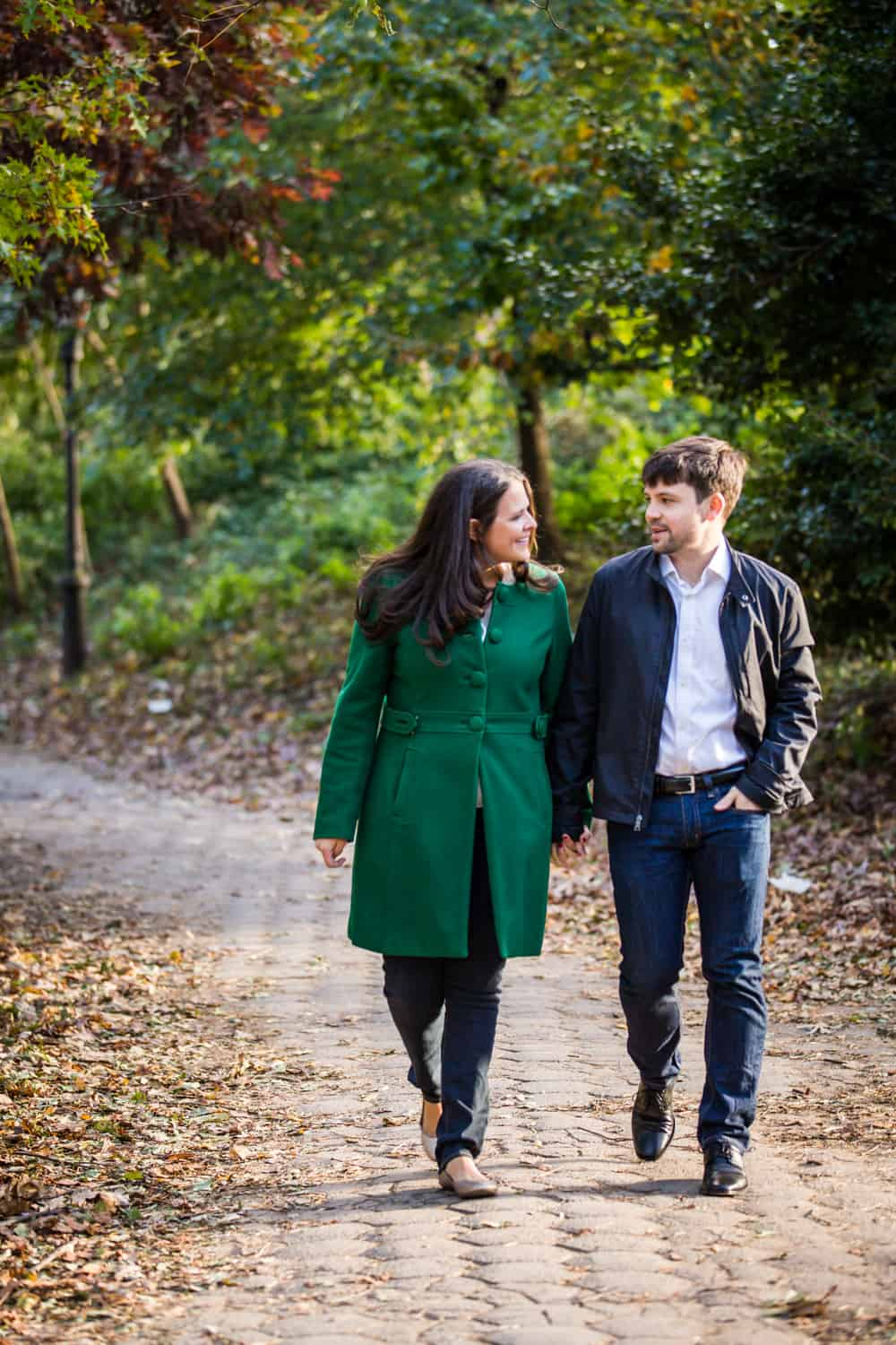 Couple walking hand-in-hand in Prospect Park