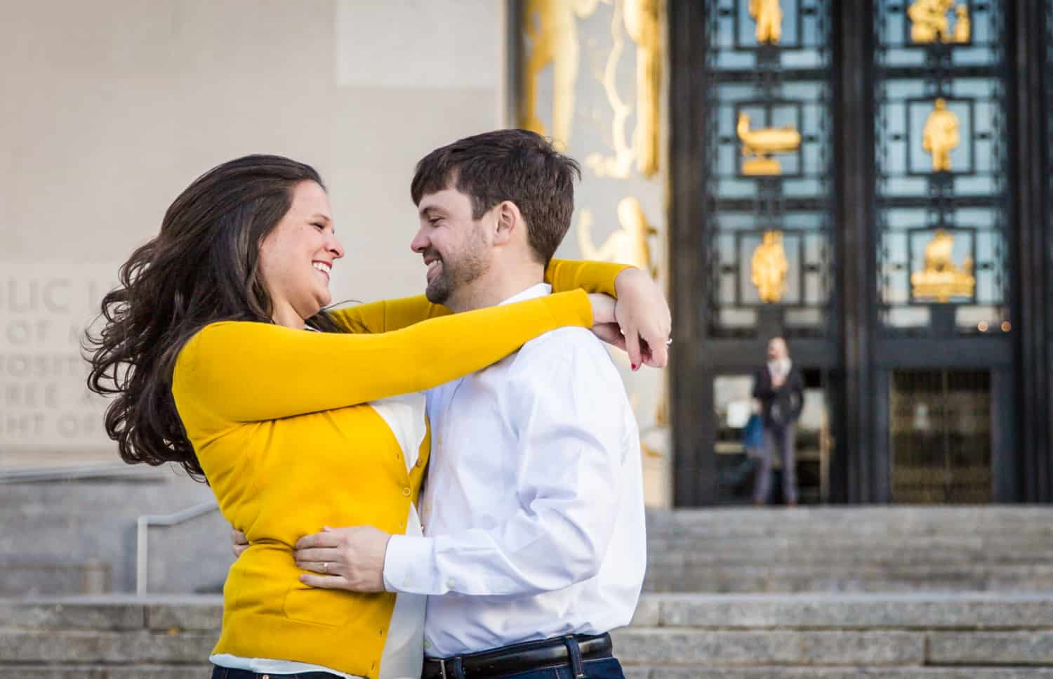 Couple hugging in front of Brooklyn Library