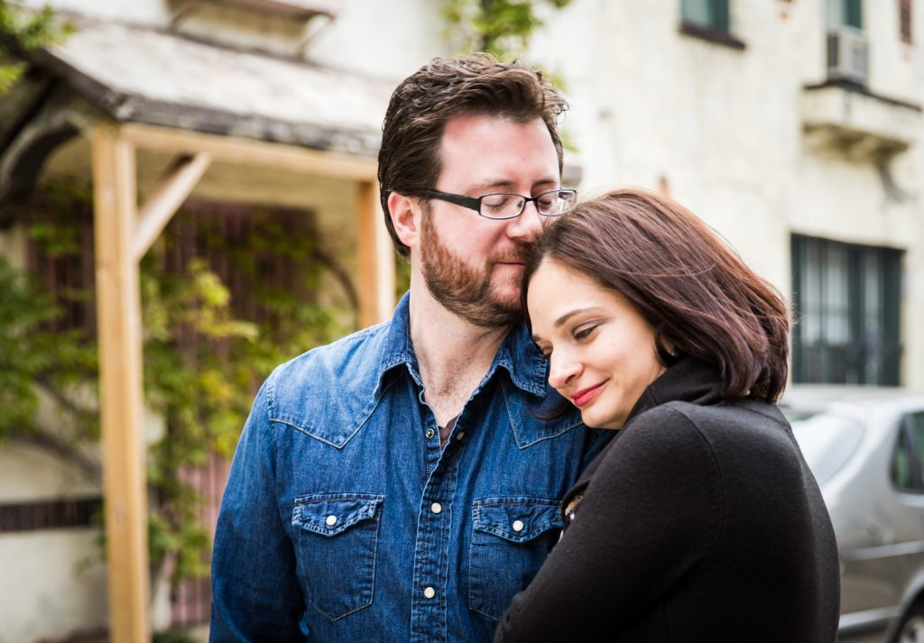 Couple standing in middle of Washington Mews during a Greenwich Village engagement session