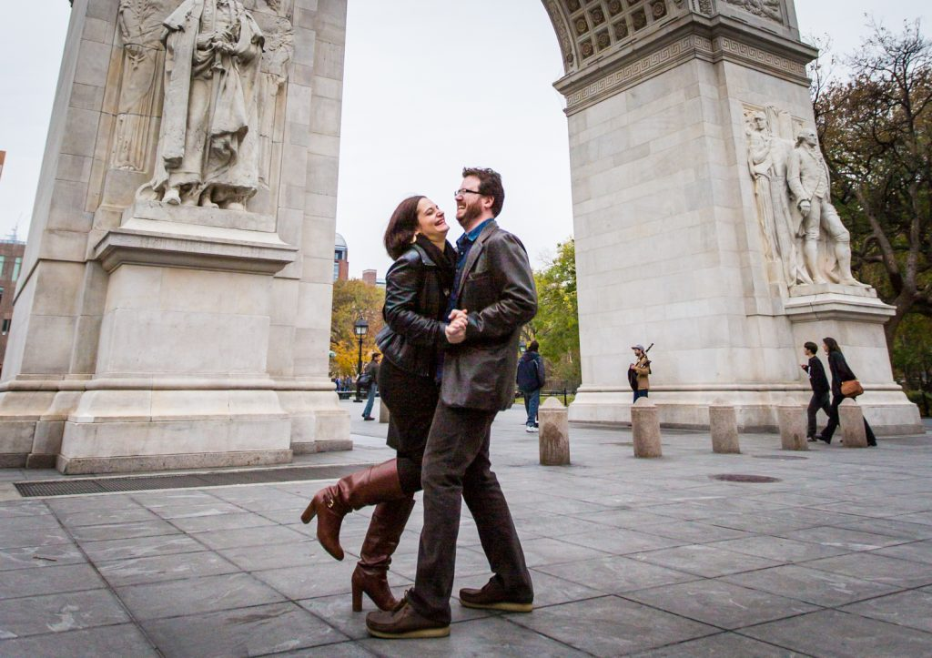 Couple dancing in front of Washington Square Arch during a Greenwich Village engagement session