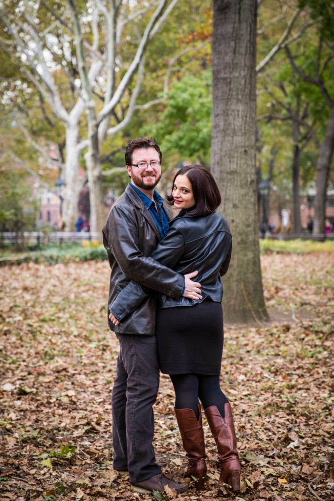 Couple walking in Washington Square Park during a Greenwich Village engagement session