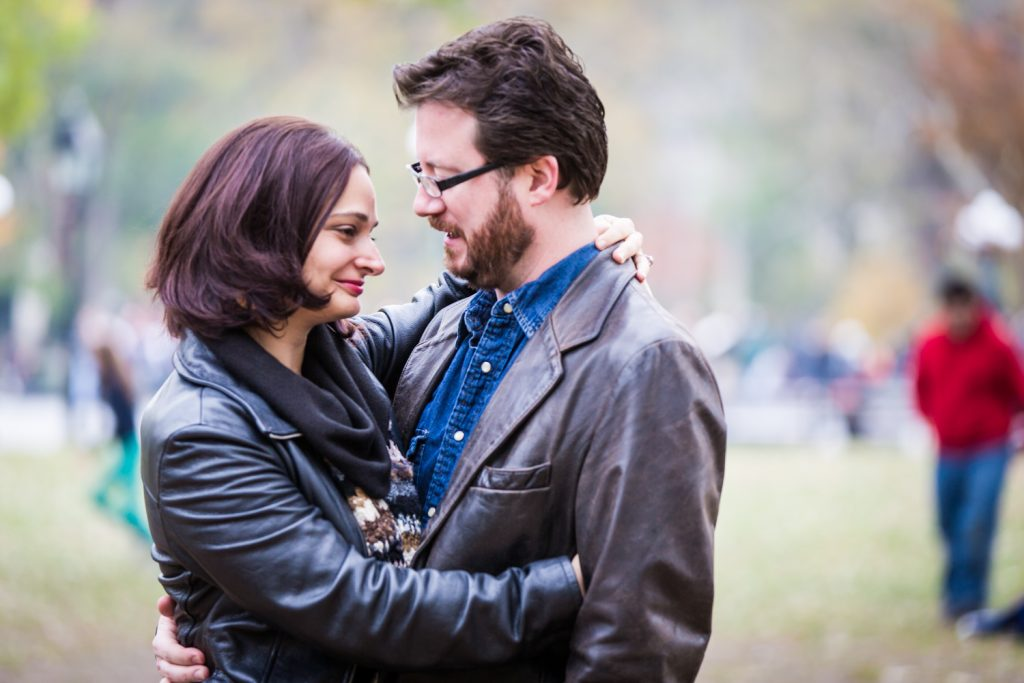 Couple hugging in Washington Square Park during a Greenwich Village engagement session