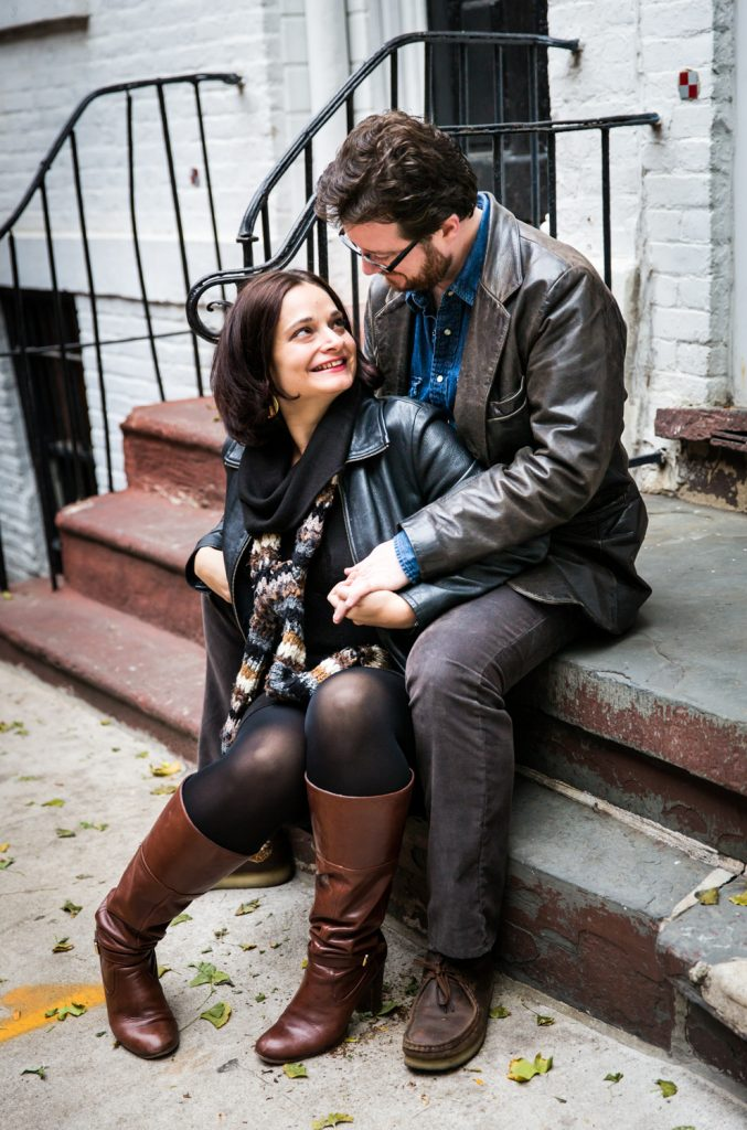 Couple sitting on steps in Greenwich Village