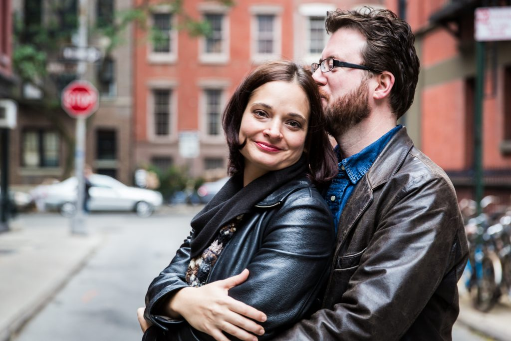Couple hugging in middle of street during a Greenwich Village engagement session