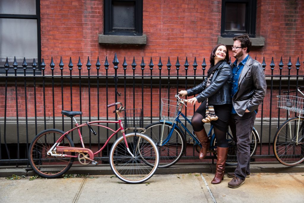 Couple on bicycle on sidewalk in Greenwich Village