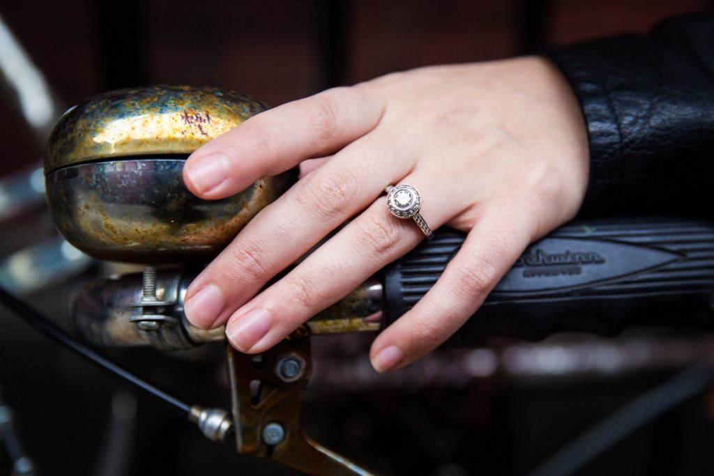 Close up on woman's hand wearing engagement ring