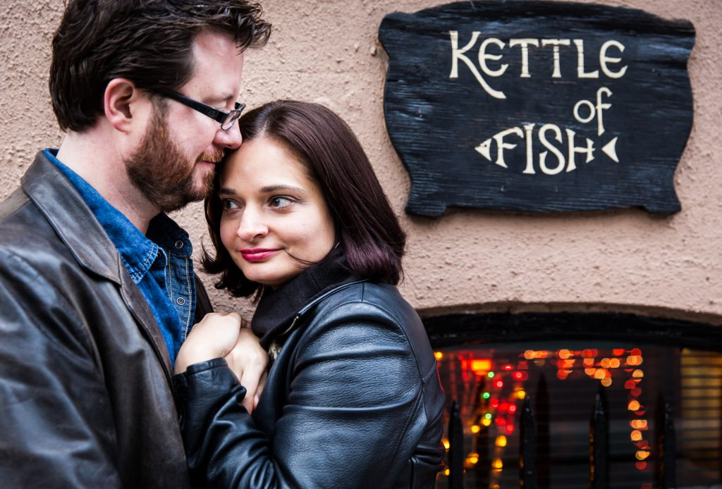 Couple kissing by Kettle of Fish sign