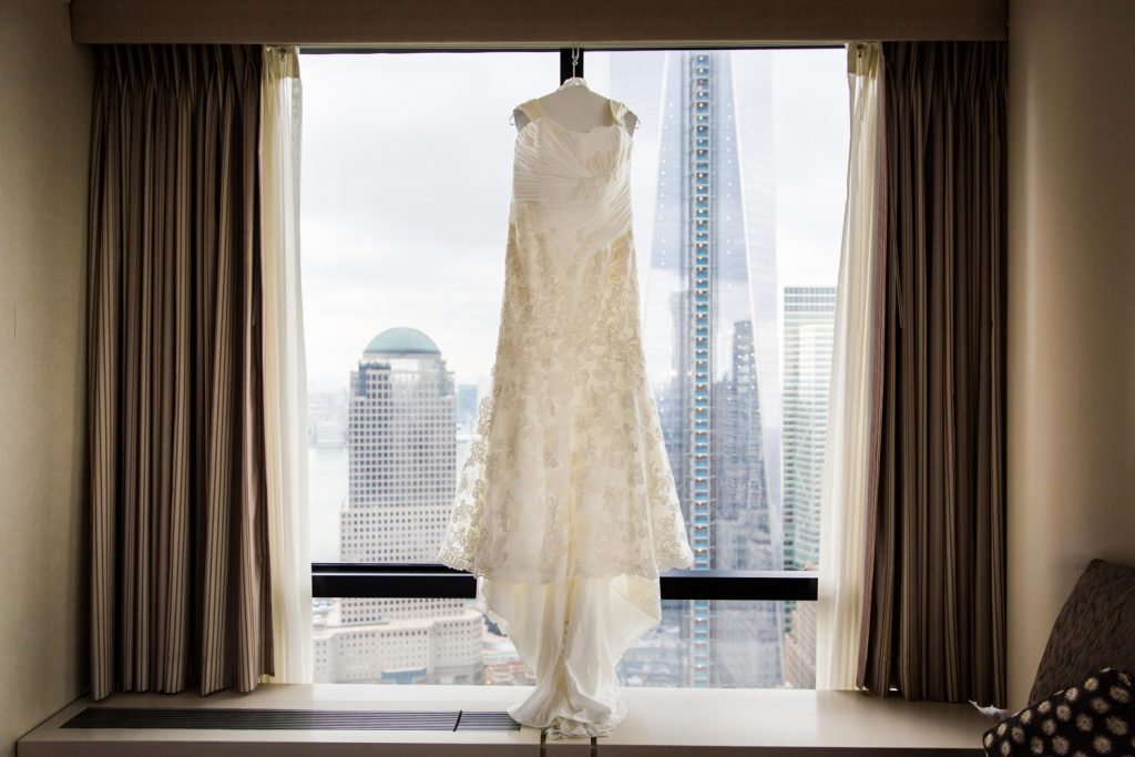 Wedding dress hanging in a hotel window for a Locanda Verde wedding