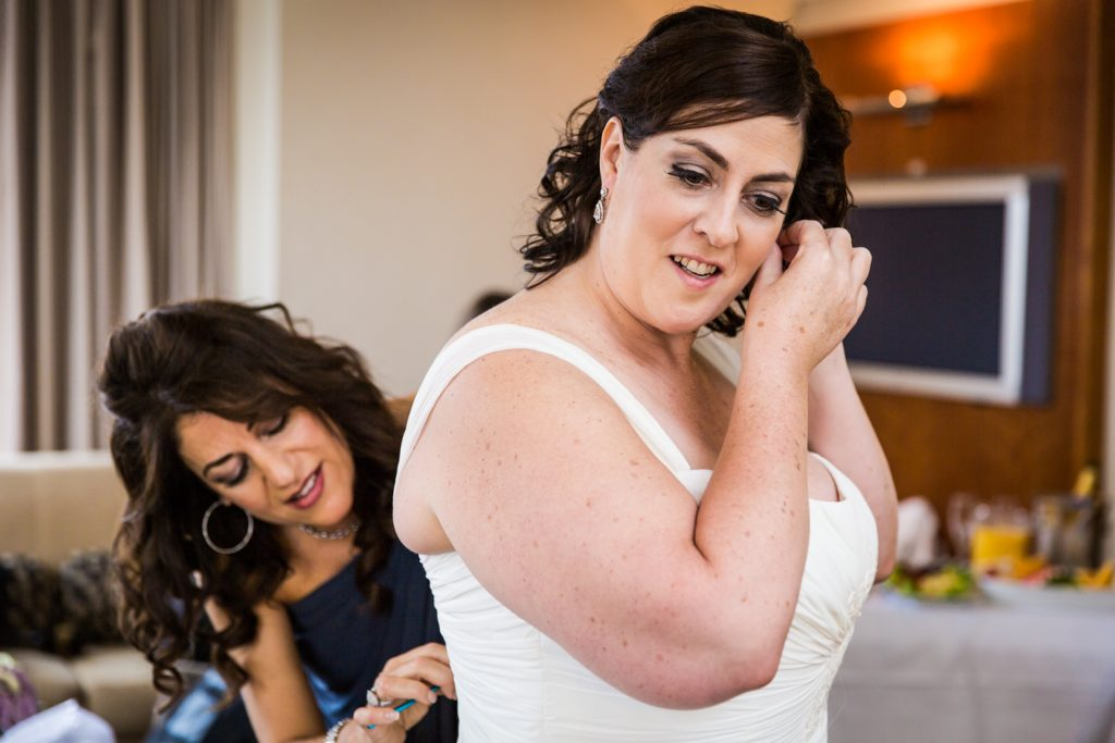 Bride putting on her earrings for a Locanda Verde wedding