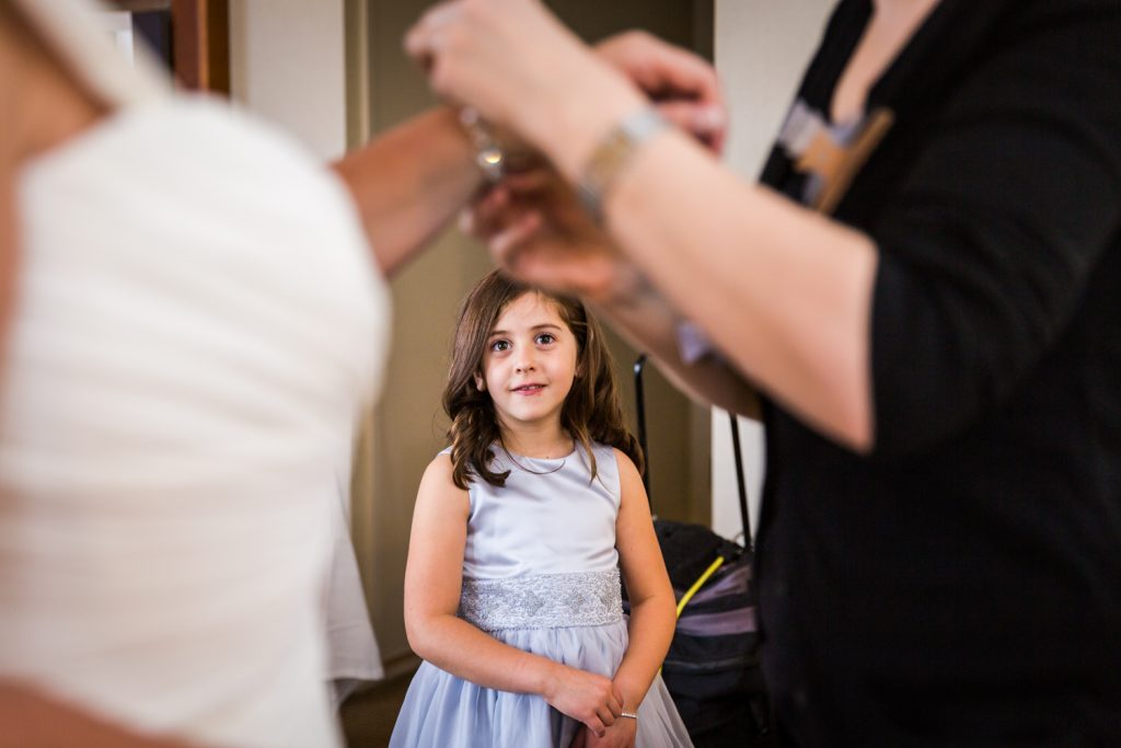 Little girl watching bride get ready for a Locanda Verde wedding