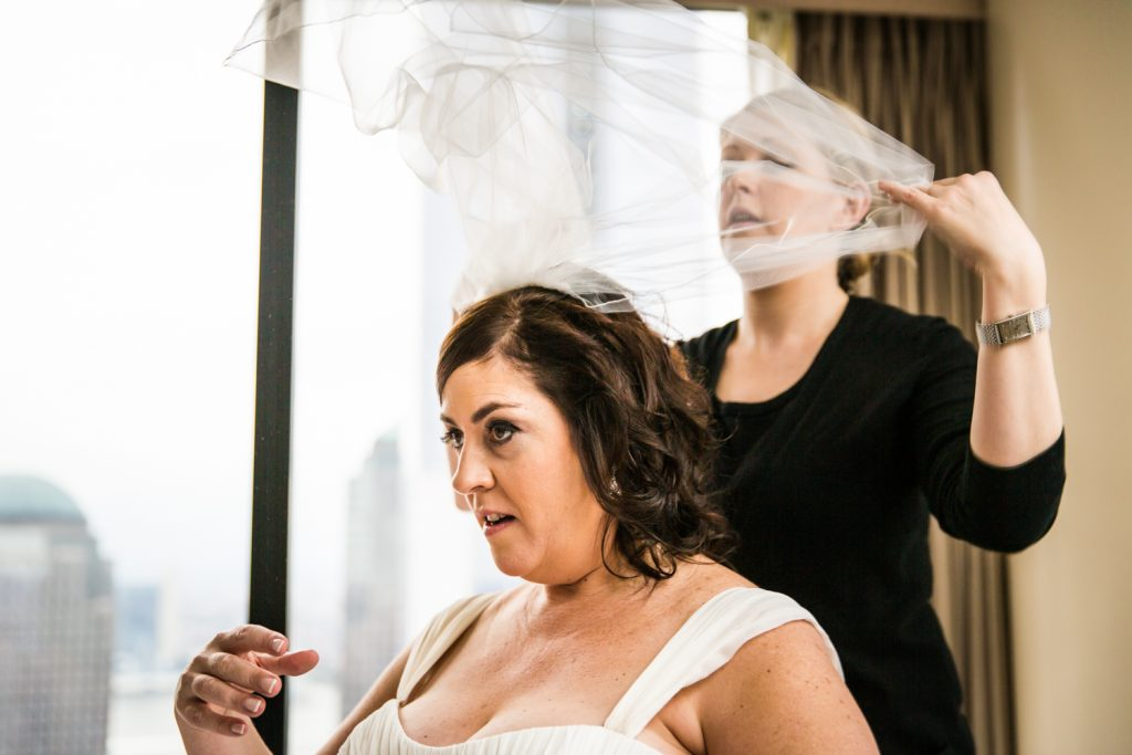 Bride flipping back her veil for a Locanda Verde wedding