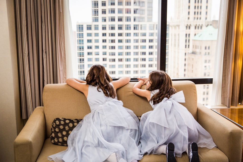 Little girls looking out a hotel window