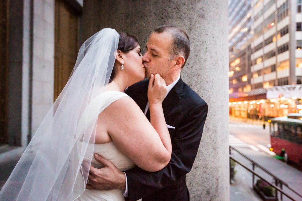 Bride and groom kissing outside St. Peter's Church