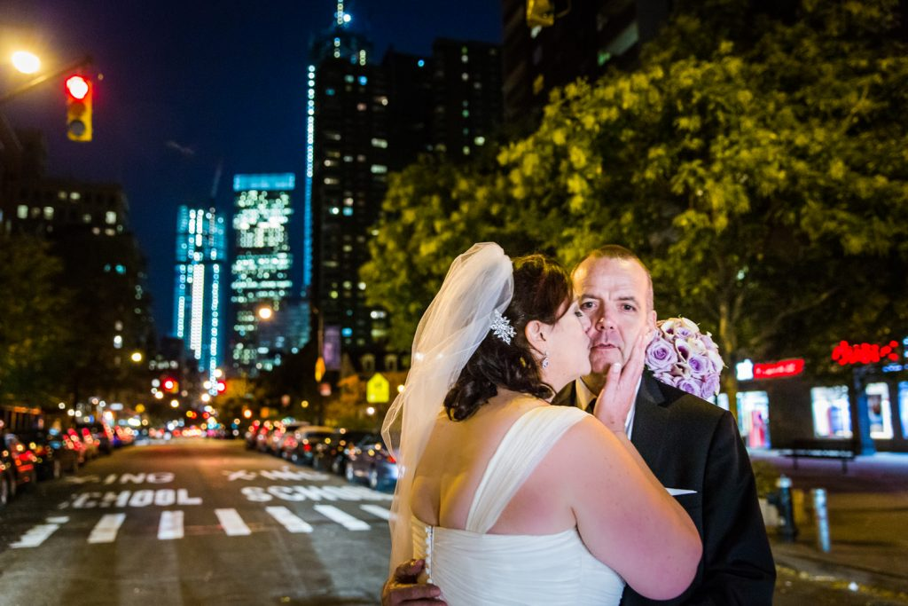 Bride kissing groom in middle of Tribeca crosswalk