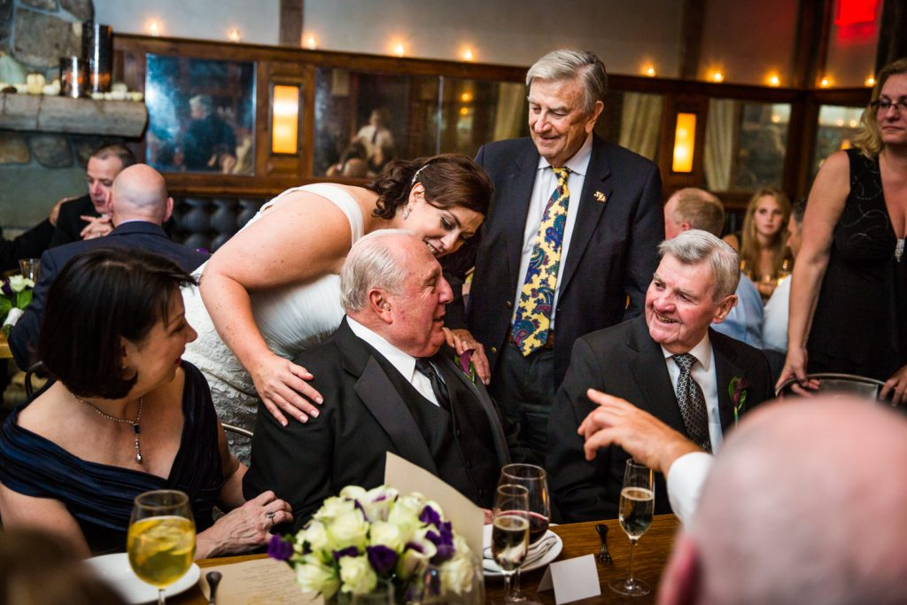 Bride and guests hugging father at a Locanda Verde wedding