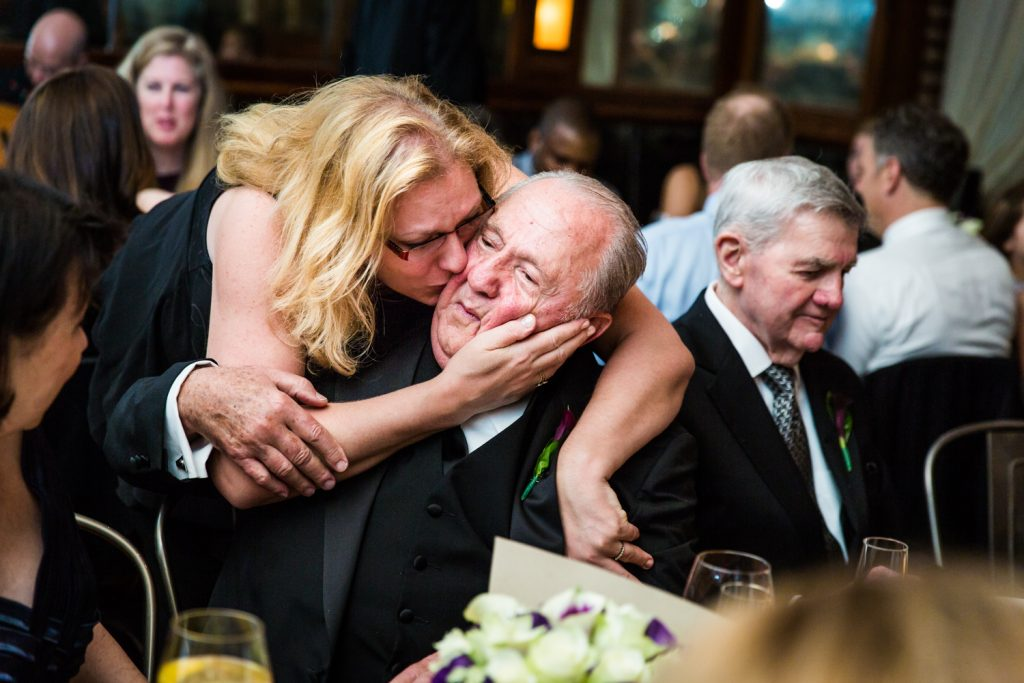 Guest hugging father at a Locanda Verde wedding