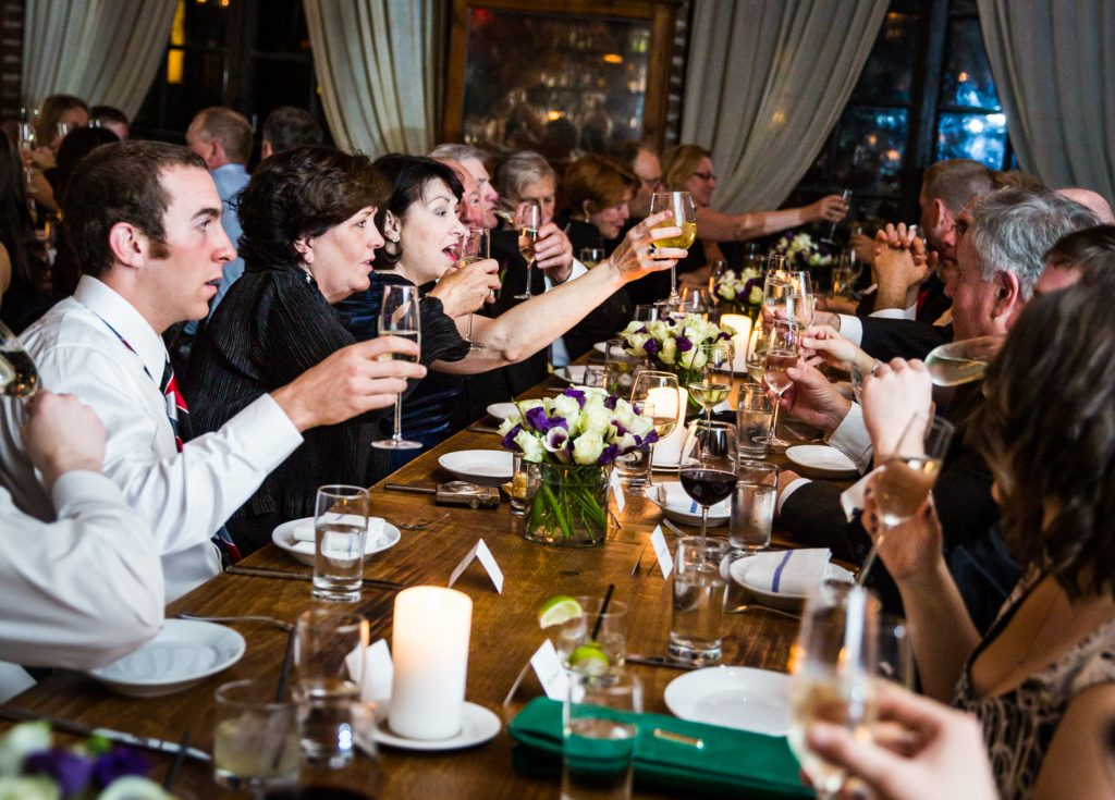 Guests toasting at a Locanda Verde wedding