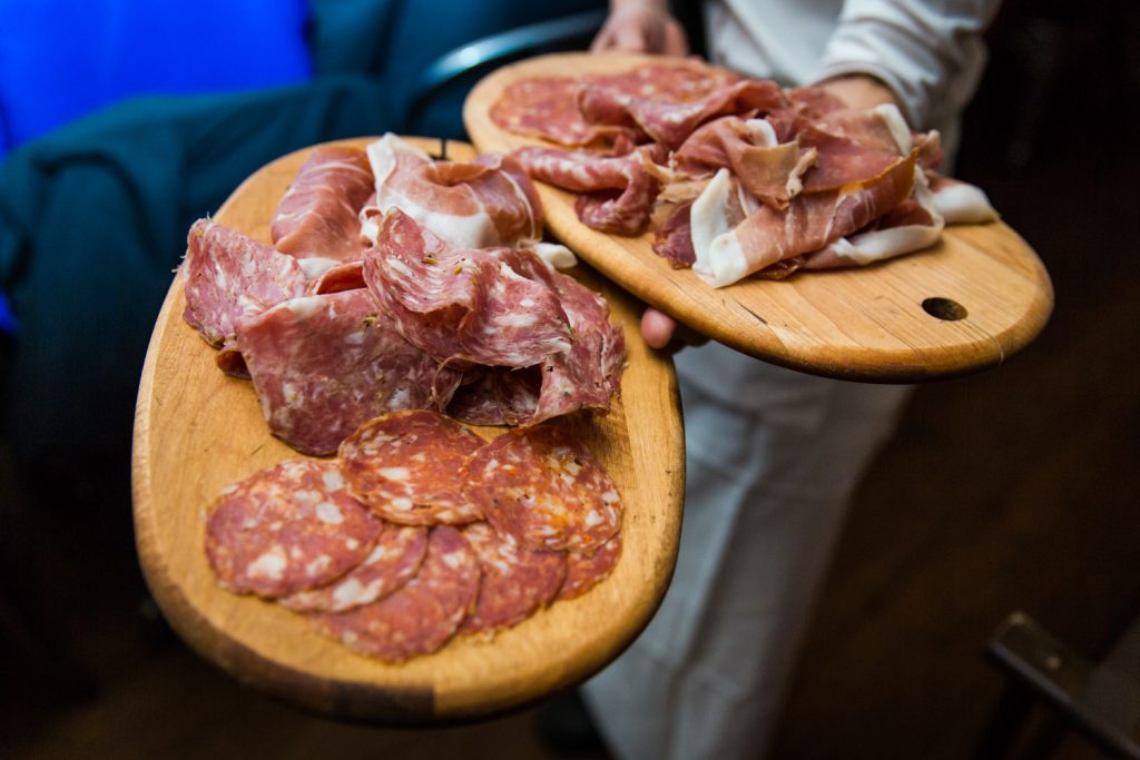 Plates of cured meats at a Locanda Verde wedding