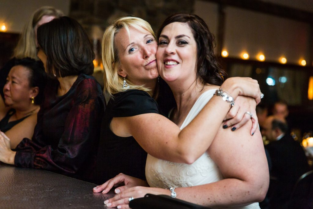 Guest hugging a bride at a Locanda Verde wedding