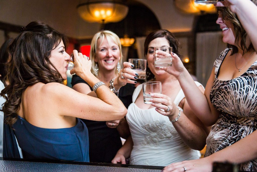 Bride and female guests enjoy shots at a Locanda Verde wedding