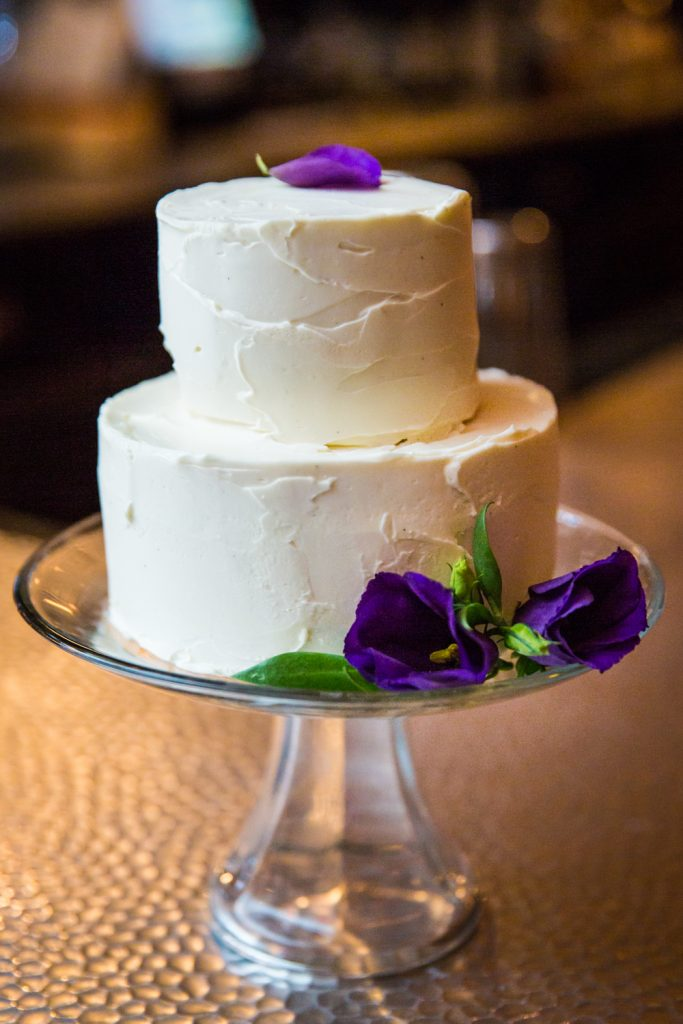 Wedding cake with flowers at a Locanda Verde wedding