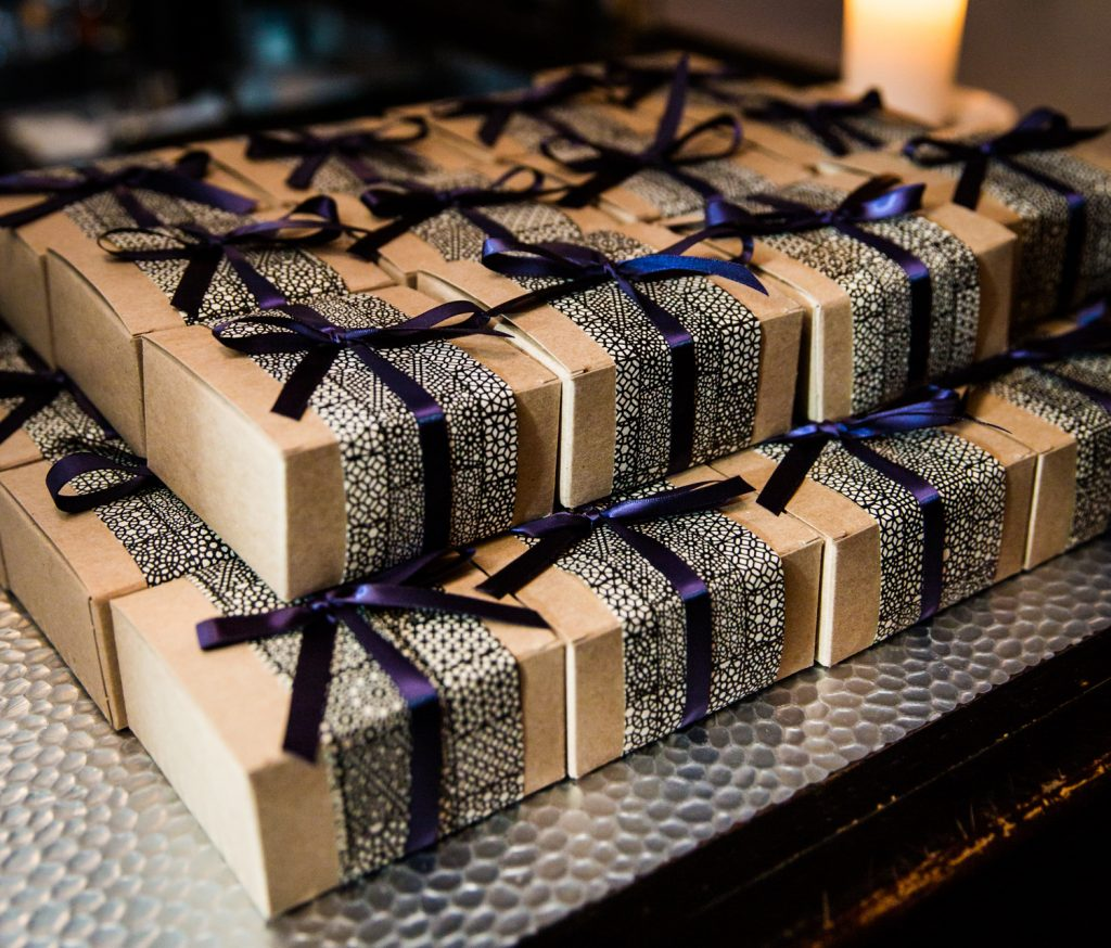 Guest favor boxes with blue ribbons at a Locanda Verde wedding