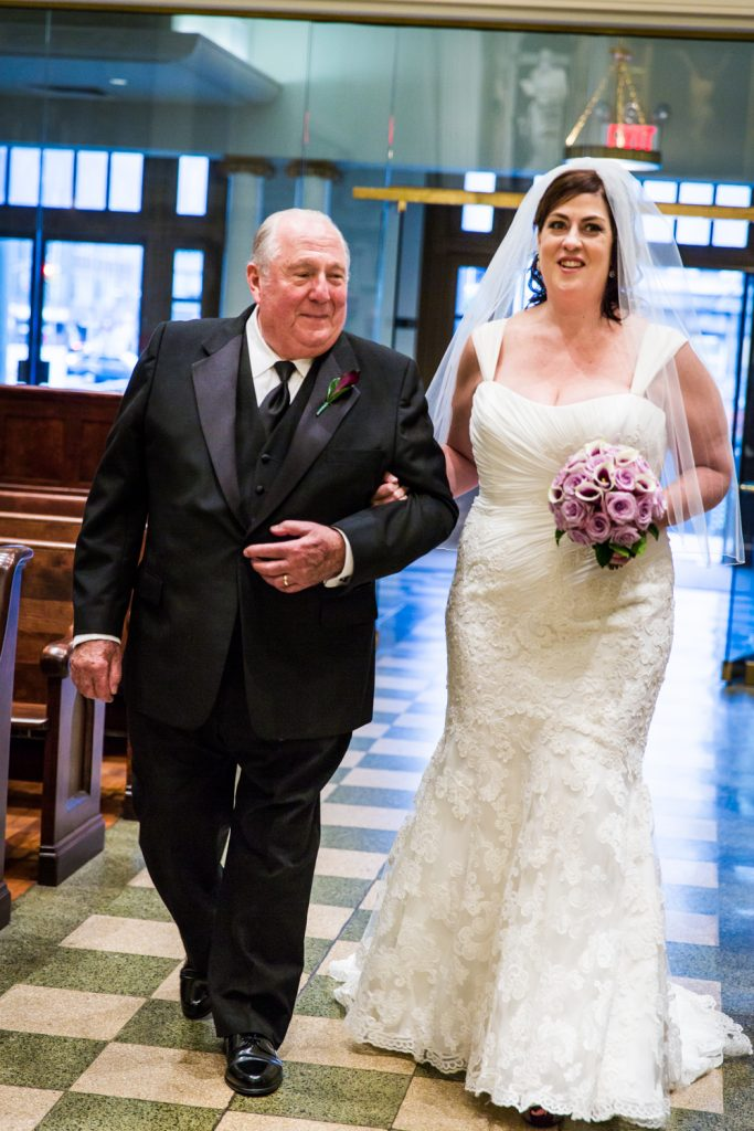 Bride and father walking down aisle at St. Peter's Church wedding