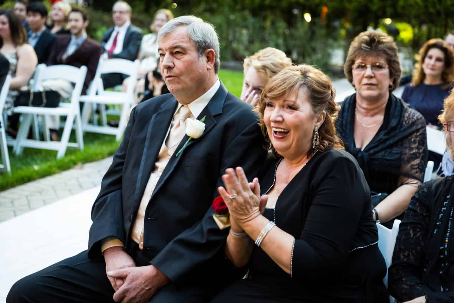 Parents of the bride listening to wedding ceremony