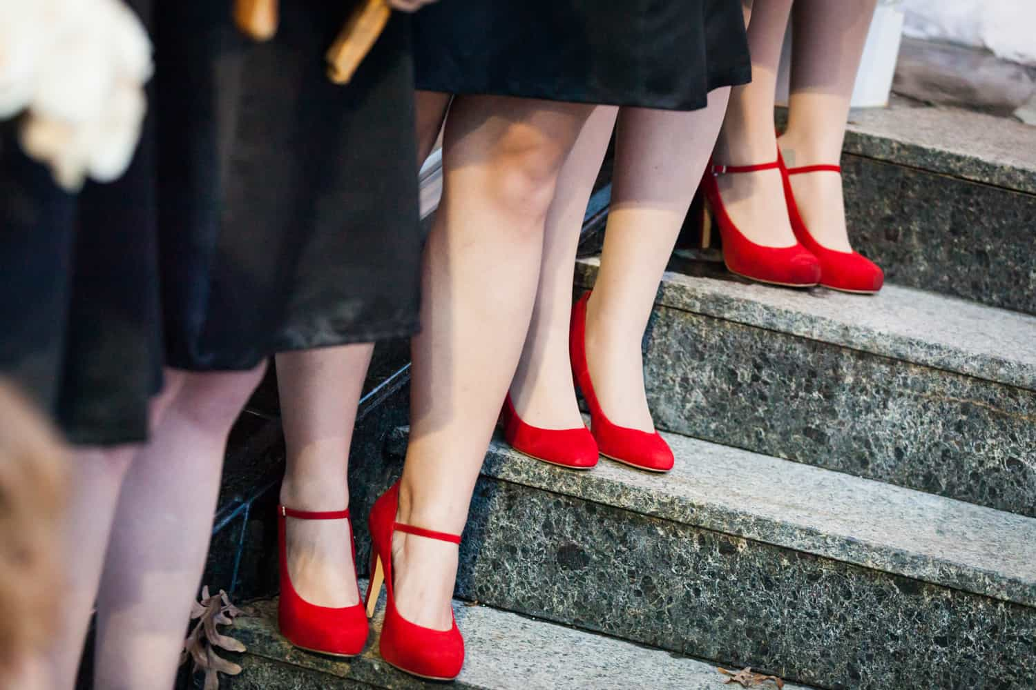 Close up on bridesmaids all wearing red high heels