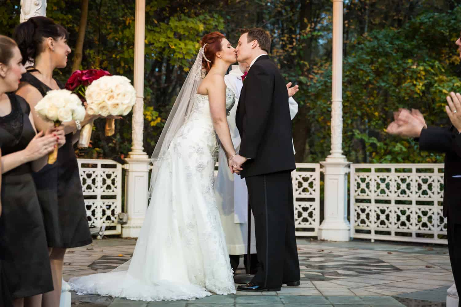 Nicotra's Ballroom wedding photos of bride and groom kissing at end of ceremony