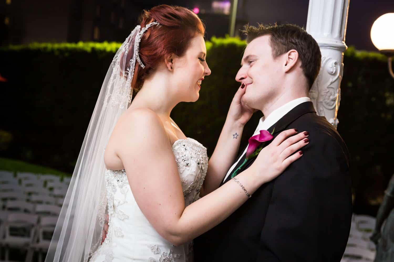 Nicotra's Ballroom wedding photos of bride touching groom's cheek