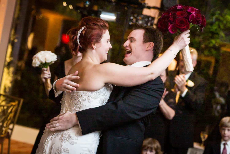 Nicotra's Ballroom wedding photos of bride and groom hugging on dance floor