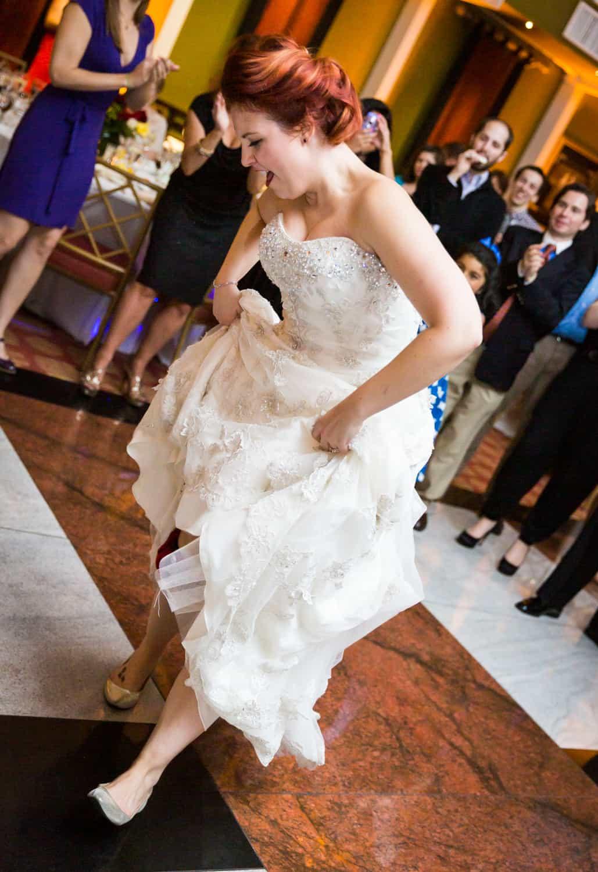 Nicotra's Ballroom wedding photos of bride lifting dress and dancing