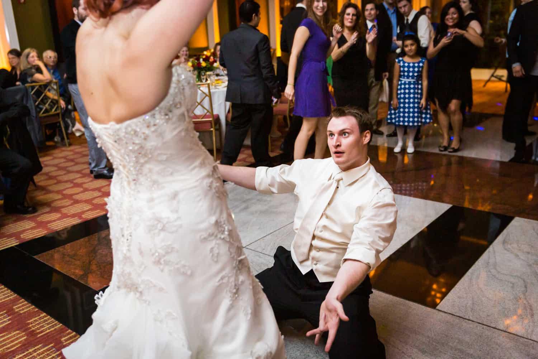 Nicotra's Ballroom wedding photos of groom on floor looking up at bride