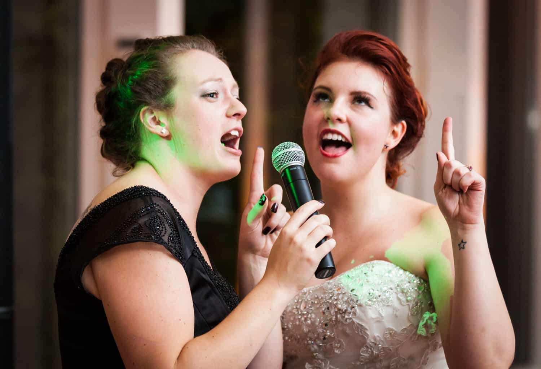 Nicotra's Ballroom wedding photos of bride and bridesmaid singing