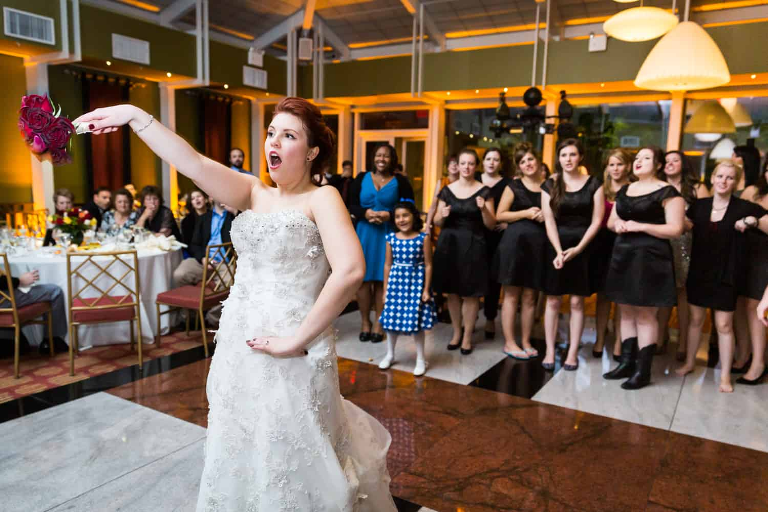 Nicotra's Ballroom wedding photos of bride after throwing bouquet to female guests
