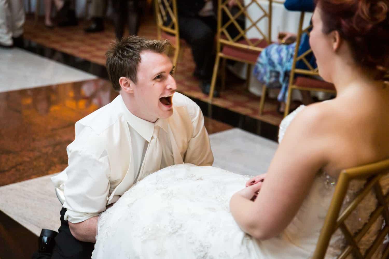 Nicotra's Ballroom wedding photos of groom reaching under bride's dress