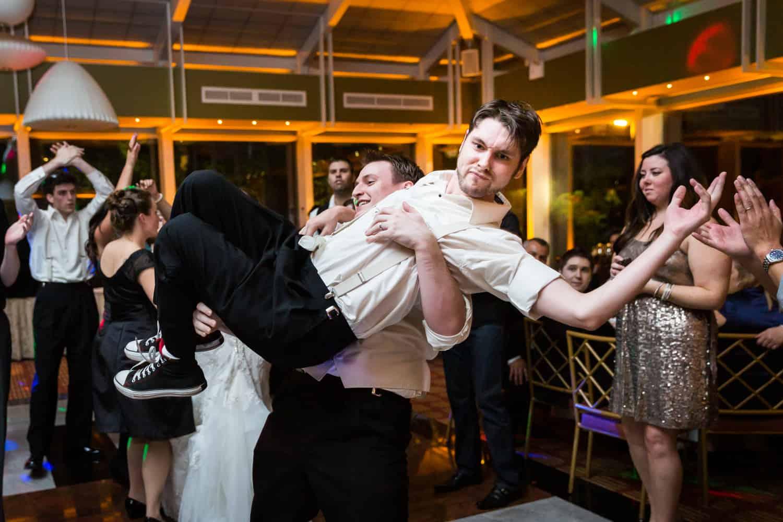 Nicotra's Ballroom wedding photos of groom lifting up groomsman on dance floor