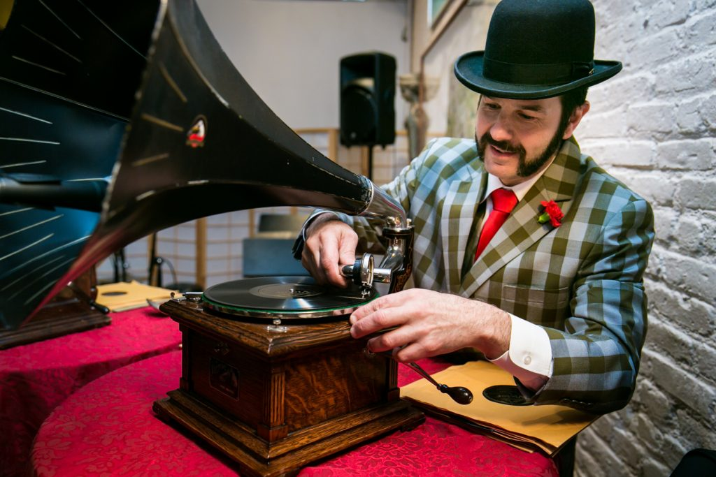 DJ Michael of Michael Cumella's Crank-Up Phonograph Experience playing a record