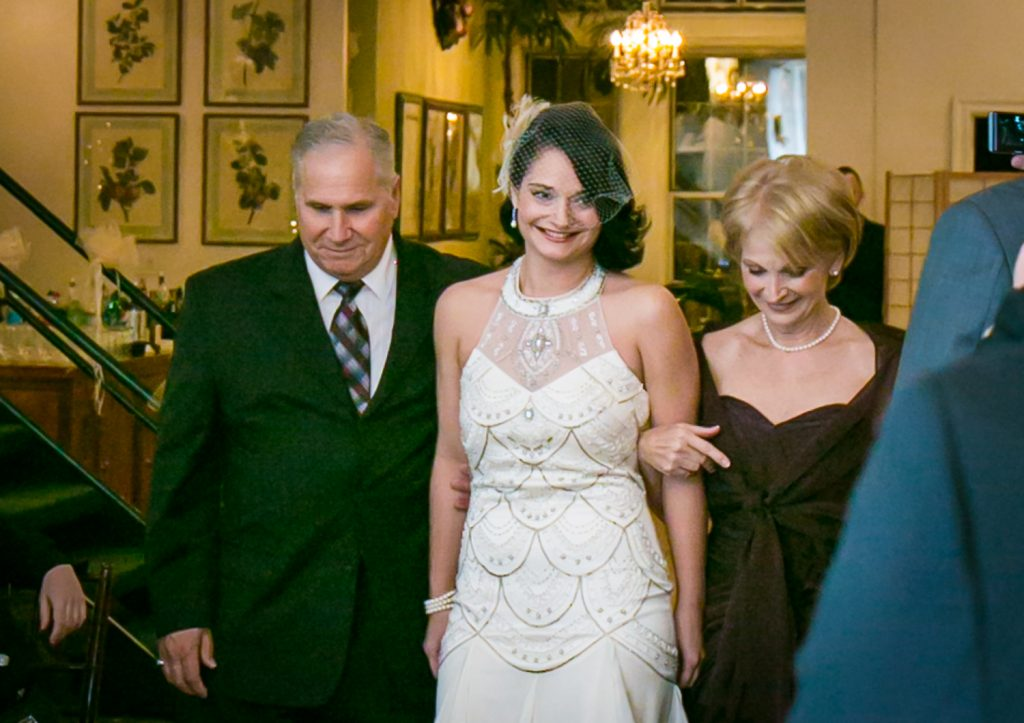 Alger House wedding photos of bride walking down aisle with both parents