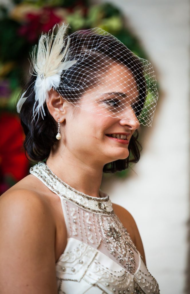 Alger House wedding photos of bride with feathered barrette during ceremony