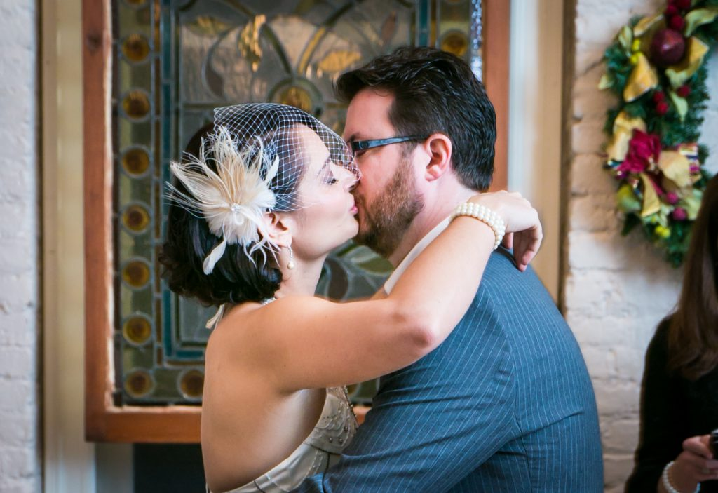 Alger House wedding photos of bride and groom kissing after ceremony