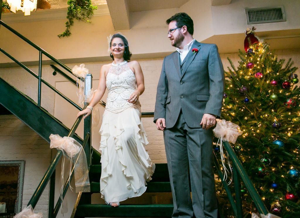 Alger House wedding photos of bride and groom walking down stairs